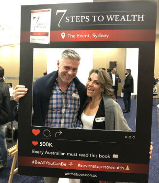 Husband and wife are taking photo together in 7 steps to wealth frame