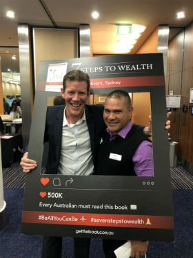 The guest took a photo with 7 Steps to wealth frame in property investment seminar in Sydney