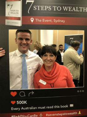 a woman is happy when she attends 7 steps to wealth seminar in Sydney to define how she could retire comfortably