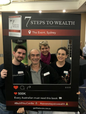 a great family is taking photo with 7 steps to wealth frame