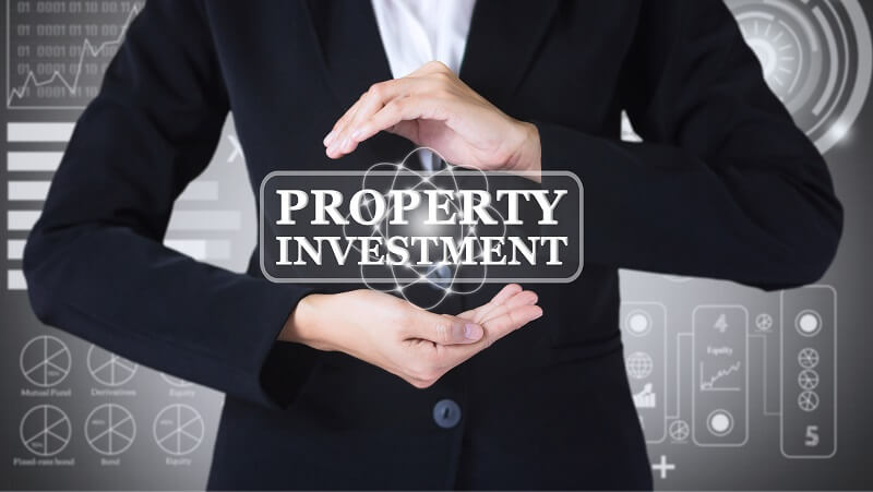 a man is working to find out the best property investment strategy