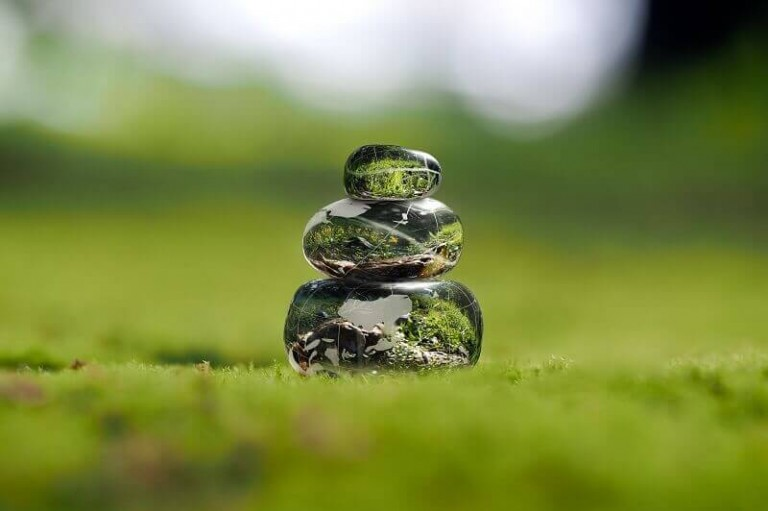 Transparent stones on a green moss presenting the power of creative thinking